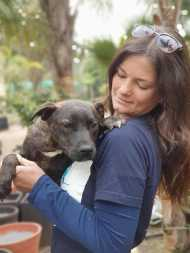 Richelle holding a rescued dog